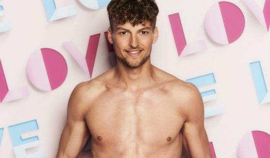 Love Island press image of Hugo Hammond - white, brown hair, shirtless