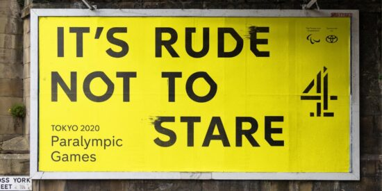 """Billboard for Channel 4's Paralympic coverage, black text on yellow background reading """"It's rude not to stare"""""""