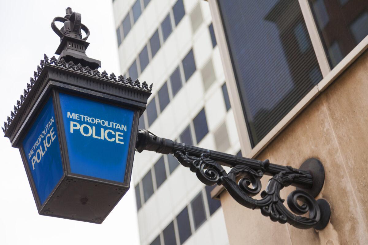 """british police lamp sign saying """"metropolitan police"""""""